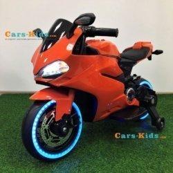 Детский электромотоцикл Ducati 12V- FT-1628 оранжевый (колеса светящиеся, сиденье кожа, музыка, страховочные колеса, ручка газа)